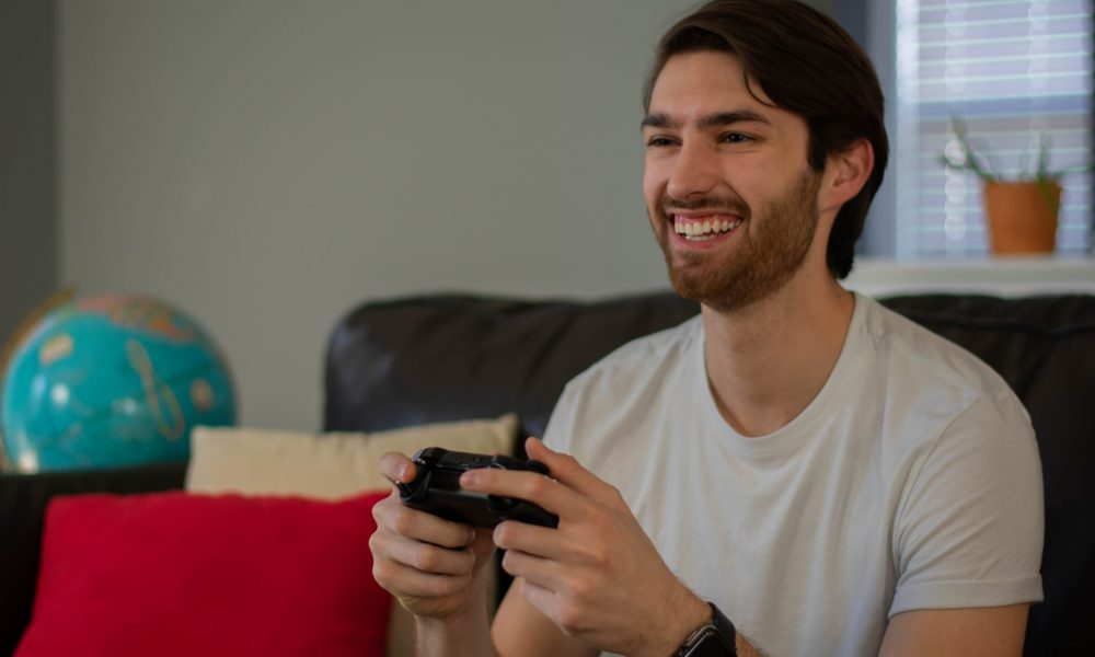 Candid photo of a man having a good time playing video games